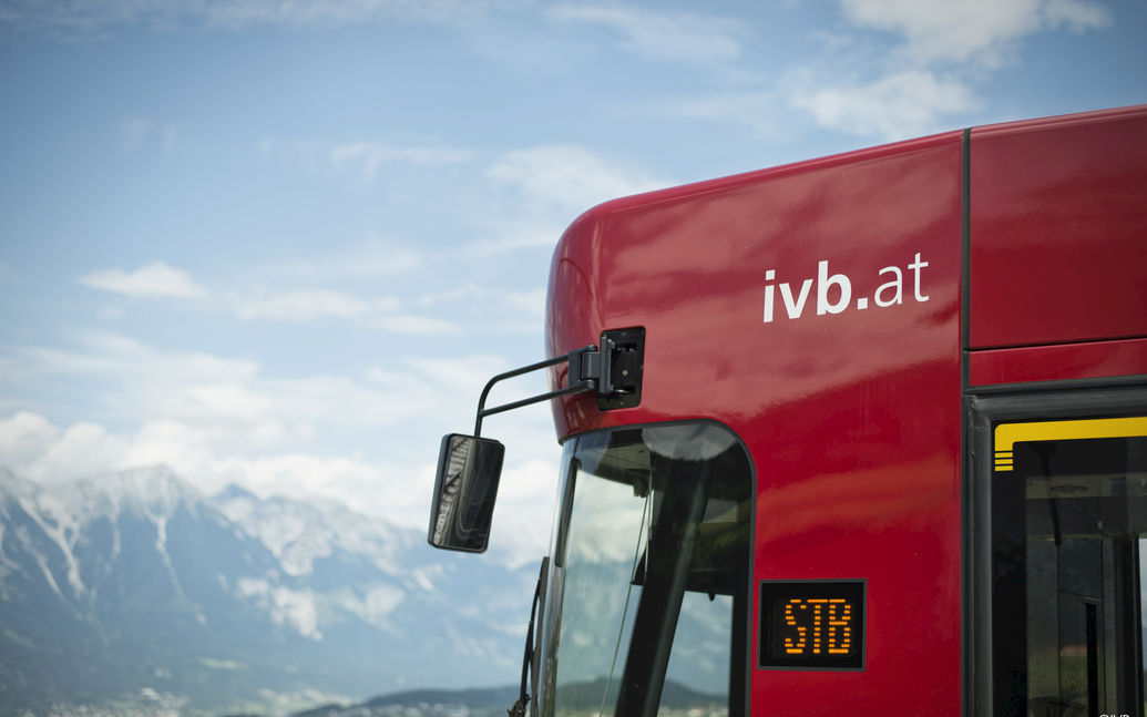 Outline of IVB tram with mountains in background